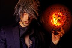 handsome-wizard-fireball-showing-black-background-49846858